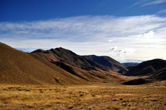 Lindis Pass Scenery. The dramatic Lindis Pass links the Mackenzie Basin with Central Otago. The actual pass crosses a saddle between the valleys of the Lindis Stock Images