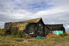 Lindisfarne. Upturned boats used as storage sheds on Holy Island in Northumbria Stock Image