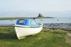 Lindisfarne castle, bay and boat Stock Photography
