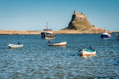 Lindisfarne Castle with boats Royalty Free Stock Images