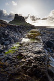 Lindisfarne Castle, Holy Island, Northumberland. England.UK. Lindisfarne Castle, Holy Island. Northumberland, England, in early morning just after sunrise Royalty Free Stock Photography