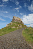 Lindisfarne Castle and path Royalty Free Stock Image