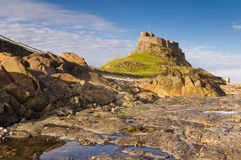 Lindisfarne Castle from the Rocks Royalty Free Stock Photo