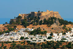 Lindos. Castle with white houses Stock Image