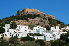 Lindos. Castle with white houses under the hill Stock Images