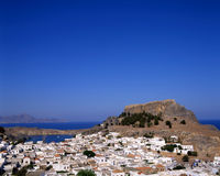 Lindos. View looking over the town of Lindos, Rhodes, Greece with the castle in the background royalty free stock image