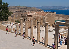 Lindos acropolis. Visiting ancient pillars in Lindos acropolis, Greece Stock Photography