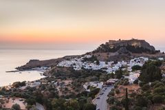 Lindos Castle and village, Greece. Lindos with the castle above on the Greek Island of Rhodes royalty free stock photography