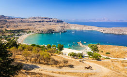 Lindos castle view for sea bay and donkey trail Stock Photography