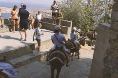 Tourists ride the donkeys in Lindos royalty free stock images