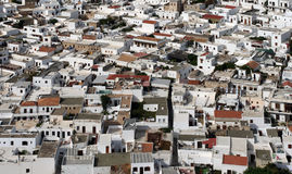 Lindos maze , Rhodes , Greece. Lindos ( Rhodes island , Greece ) with its white cube-shaped houses which combine Byzantine and Arabic styles royalty free stock photography