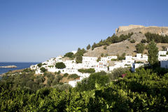 Lindos - Rhodes. Above the modern town rises the acropolis of Lindos - Greece Royalty Free Stock Photo