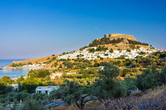 Lindos Rhodes Greece. Little white houses with the Castle of Lindos above Rhodes Dodecanese Greece Europe Stock Images