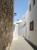 Lindos, Rodos, Greece. One of the picturesque ancient streets of Lindos (Rodos, Greece) under blue sky Stock Photography