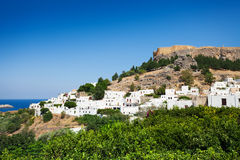 Lindos town at the foot of mountain and Acropolis Royalty Free Stock Image