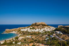 Lindos town at the foot of the mountain. Acropolis Lindos. Stock Image