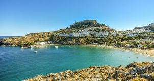 Lindos village and the endless Aegean sea photo taken from Kleovoulos Tomb hill. LINDOS,RHODES/GREECE OCTOBER 29 2018 : Lindos village and Lindos bay,photo taken royalty free stock images