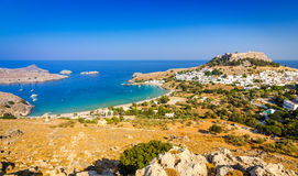 Lindos village with turquoise color sea bay Stock Images