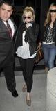 Lindsay Lohan am LOCKEREN Flughafen lizenzfreie stockfotos