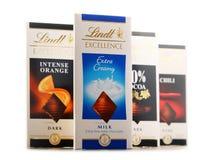 Lindt在白色隔绝的不同的口味巧克力块 库存图片