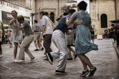 Lindy Hop Flash Mob. Flash Mob itinerant in the city center of Parma, Italy. The Swing is coming back with all his energy and all his load of happiness Stock Image