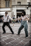 Lindy Hop Flash Mob. Flash Mob itinerant in the city center of Parma, Italy. The Swing is coming back with all his energy and all his load of happiness Royalty Free Stock Photo