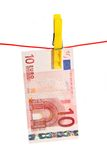 On the Line. 10 Euro Bill on a Clothes Line on White Background royalty free stock images