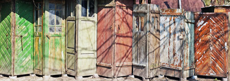 It is the line of aged vintage cracked wooden old doors Royalty Free Stock Photos
