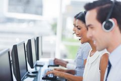 Line of agents working on computers Royalty Free Stock Images