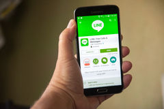 Line App. Roseville, CA/USA - July 15, 2016: An Android user installs Line Corporation's new app for free calls, messaging and chats. A Japanese company, Line's Royalty Free Stock Image