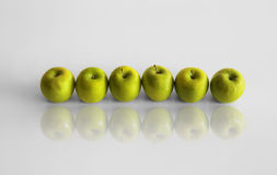 Line of apples Stock Photos