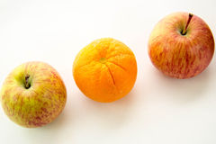 Line of apples with one orange Stock Photography