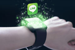 Line application with smartwatch. Royalty Free Stock Photography