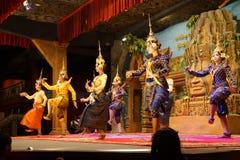 Line of apsara dancers. SIEM REAP, CAMBODIA - FEB 14, 2015 - Line of apsara dancers perform at a recital,  Siem Reap,  Cambodia Royalty Free Stock Images