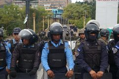 Protest March Against Reelection of Juan Orlando Hernandez Honduras 21 January 2018 12. Line of army soldiers and policeman in the middle of the  protest march Royalty Free Stock Photo