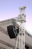 Line array speakers on music stage. With stage construction Stock Photography