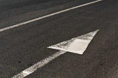 Line and arrow on asphalt surface Stock Photo