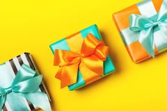 Line of attractive gifts on the yellow background