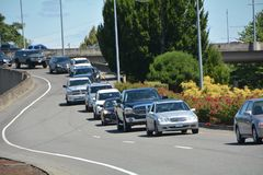 A line of backed-up traffic in Salem, Oregon. This is a line of backed-up cars coming off the Marion Street Bridge over the Willamette River coming into downtown Royalty Free Stock Image