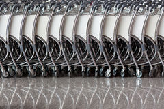 Line of baggage trolleys. Line of parked baggage trolleys at an airport Royalty Free Stock Photography