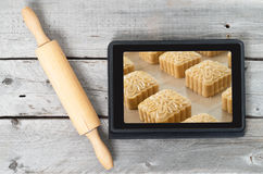 On-line bakery concept. With a touch screen tablet and rolling pin Royalty Free Stock Photos