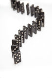 Line of balanced dominoes Royalty Free Stock Images