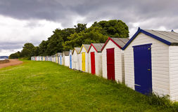 A Line of Bathing Boxes, Devon, England Royalty Free Stock Photo