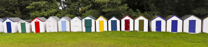 A Line of Bathing Boxes, Devon, England Stock Images