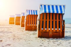 Line of beach Chairs on sandy beach on Travemuende, Luebeck Bay, Germany.  royalty free stock images