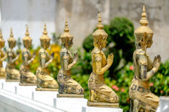 A line of beautiful Buddha statues in Thai temple Royalty Free Stock Photo