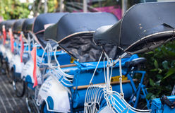 A line of becak handicap with blue color photo taken in yogyakarta indonesia Royalty Free Stock Photography