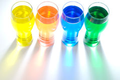 Line of beer glass and color water Stock Photography