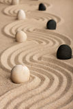 Line black and white  stones, standing on the sand Royalty Free Stock Photo