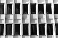 Line Of Black Windows On Modern White Building Stock Photos